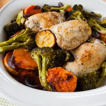 Ready in under an hour, this Easy One-Pan Roasted Chicken and Vegetables is so delicious! Make it with sweet potatoes, red onions and either broccoli or zucchini and enjoy the caramelized results!