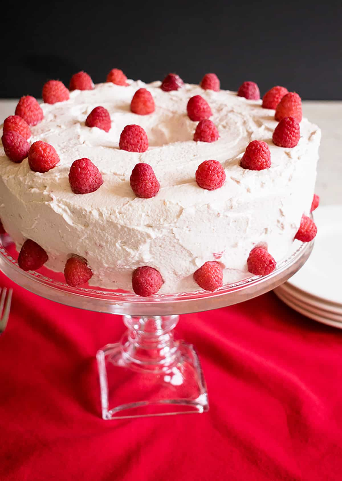 Raspberry-Almond Angel Food Cake - A fabulous dessert featuring angel food from scratch and raspberry-almond whipped cream!