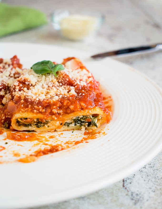 A great recipe for homemade manicotti! Make your crepes from scratch (it's not hard!) and load them with a four-cheese and spinach filling.