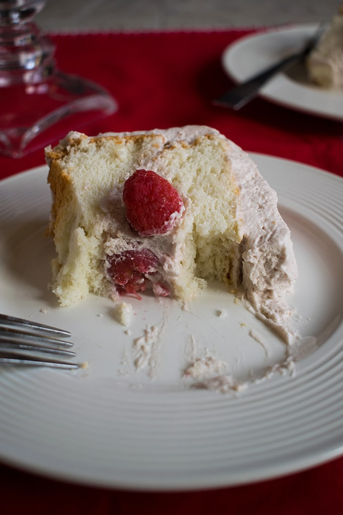 Raspberry-Almond Angel Food Cake - A dessert your friends and family will love! Featuring fresh almond angel food filled with raspberry-almond whipped cream.