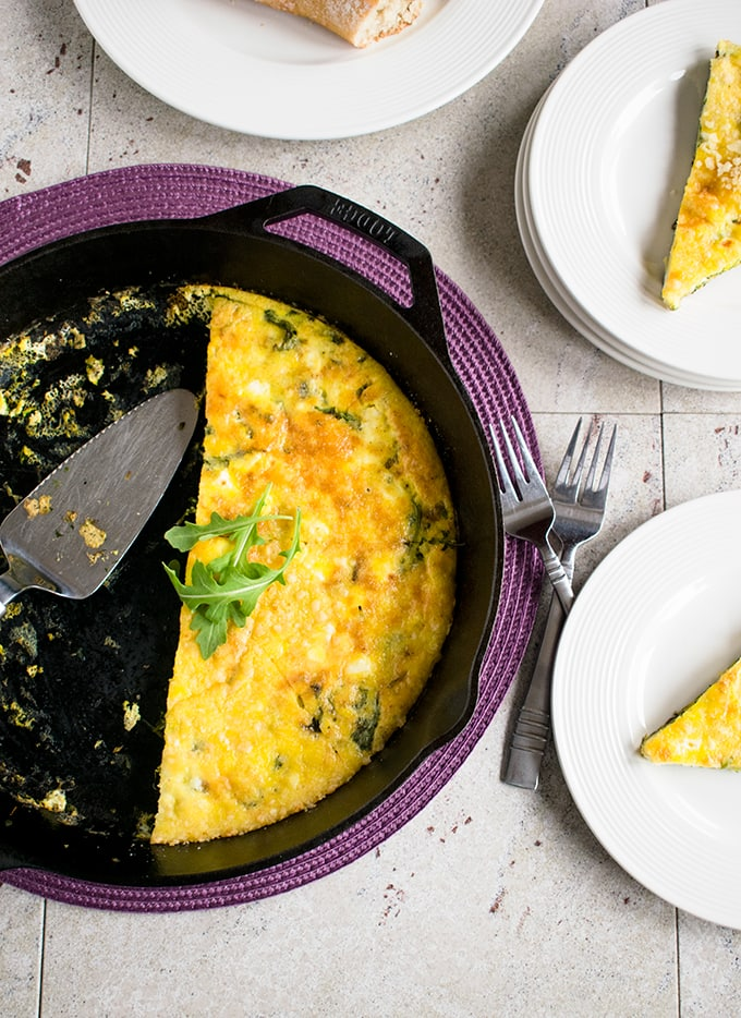 Baked Arugula Frittata - A delicious gluten-free meal with Italian greens, Parmesan, Romano, feta and garlic. Great for breakfast, brunch or any time!