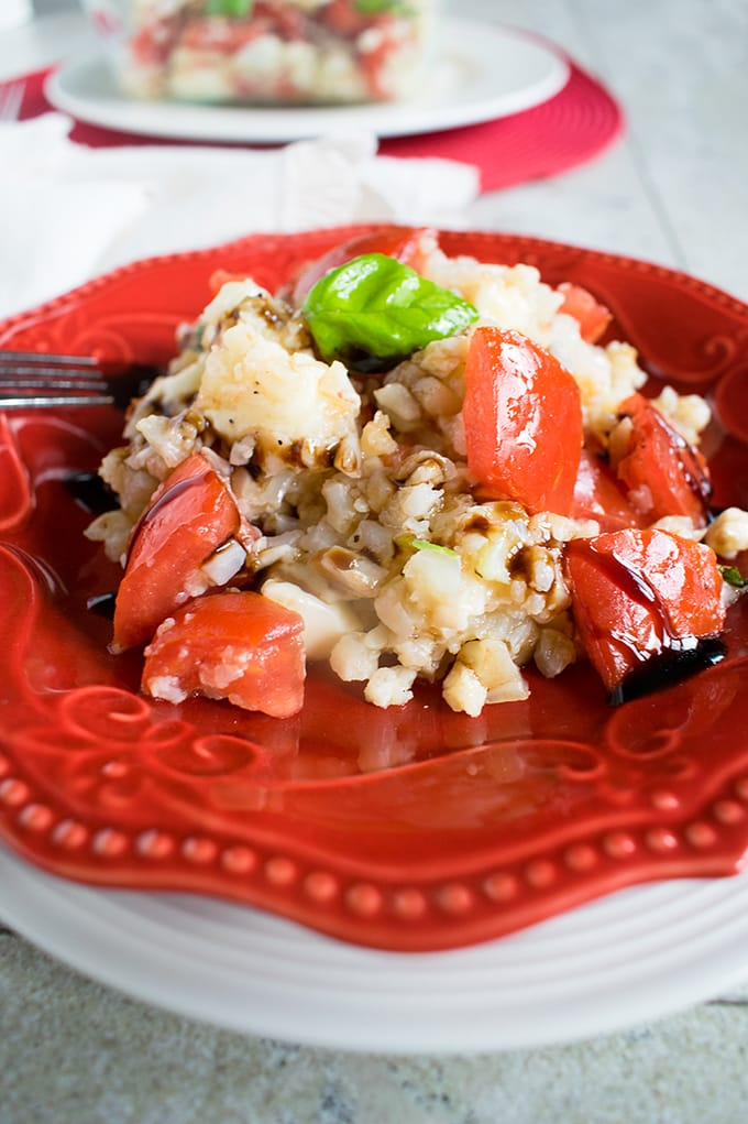 Cauliflower Rice Caprese - You can make this in seven minutes! A delicious side dish that's low carb and gluten free.