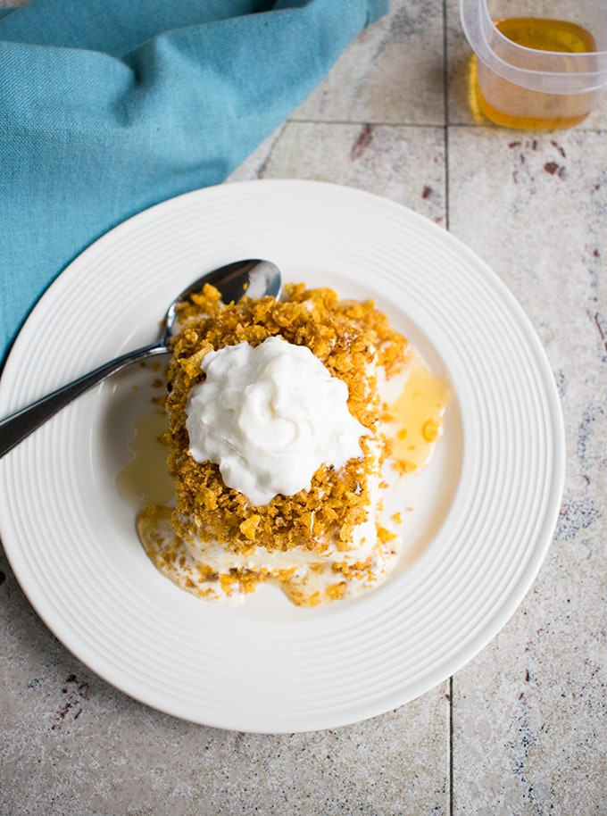 Fried Ice Cream in a Pan - Made with toasted corn flakes and topped with honey and whipped cream! A crowd-pleasing dessert!
