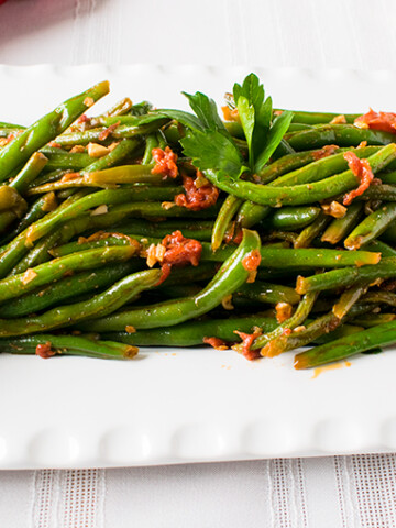close-up of Italian green beans with tomatoes on a platter
