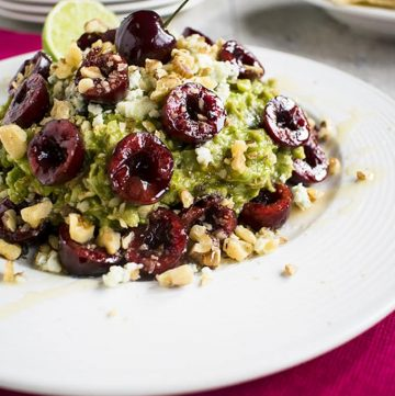 Guacamole with Cherries, Gorgonzola and Walnuts - The best gourmet guacamole dip! You'll love this recipe with toasted walnuts and honey.