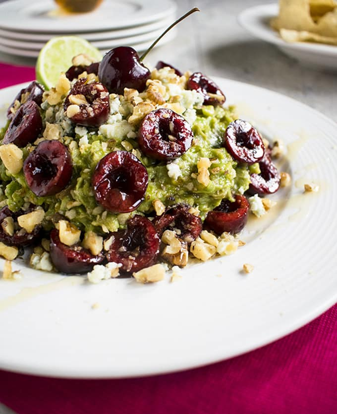 Guacamole with Cherries, Gorgonzola and Walnuts - The best gourmet guacamole dip! You'll love this gluten-free recipe with toasted walnuts and honey.
