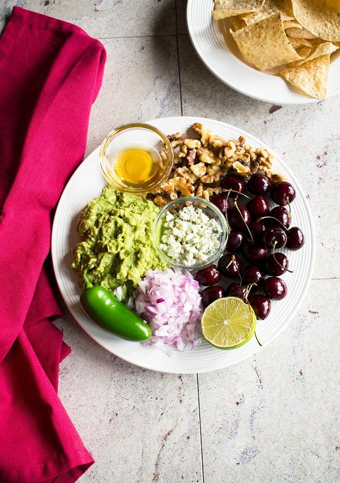 Guacamole with Cherries, Gorgonzola and Walnuts - The best sweet and savory dip! With toasted walnuts and drizzled honey. Gluten free.