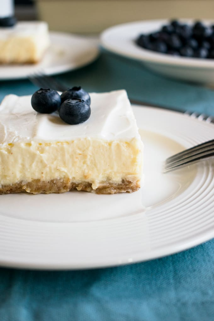 Mom's Cheesecake with Sour Cream Topping - The best 9x13 cheesecake! This dessert is always a hit!