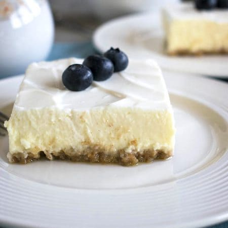 Mom's Cheesecake with Sour Cream Topping - A beloved family favorite! You'll make this 9x13 cheesecake again and again!
