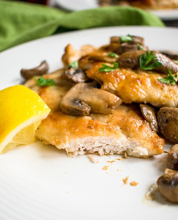 Easy Chicken Marsala with Mushrooms - Ready in 30 minutes! With delicious accents of wine and lemon. #chicken #dinner #main