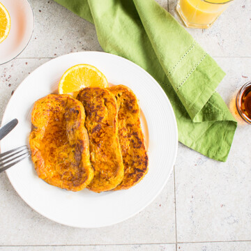 Overhead view of pumpkin-orange french toast on a plate