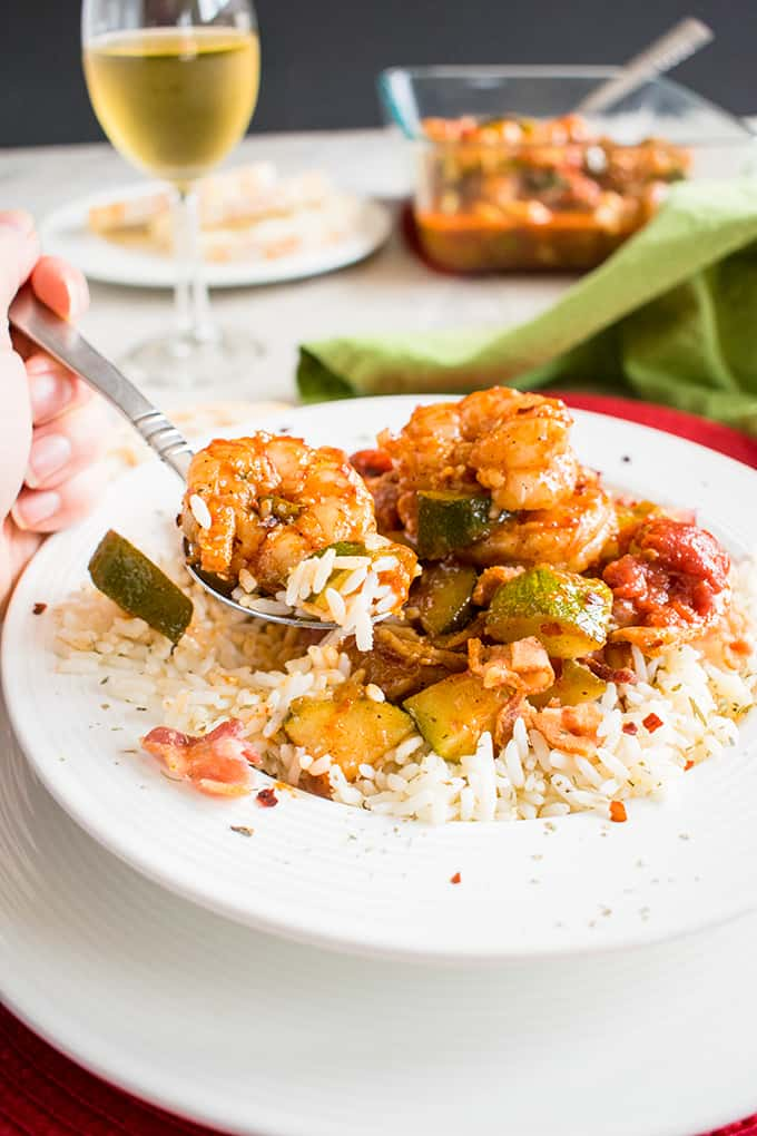 Shrimp Stew with Bacon -A gluten-free, tomato-based stew with zucchini and served over rice! With warm chili spices and a hint of smoky sweetness. #glutenfree #dinner #seafood