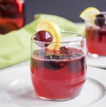 Dark Cherry Amaretto Sour - A delicious holiday cocktail that's delicious any time of year! With frozen cherries, homemade sour mix and Sprite. #cocktailrecipes #amarettosour #cocktails