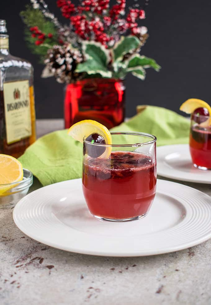 Dark Cherry Amaretto Sour - A delicious holiday cocktail that's perfect any time of year! With frozen cherries, homemade sour mix and Sprite. #cocktailrecipes #amarettosour #cocktails