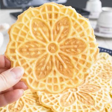 Almond Pizzelle Cookies - These Italian waffle cookies are light, crispy & delicious! A festive dessert, breakfast or snack. #pizzelle #cookies #pizzellerecipe