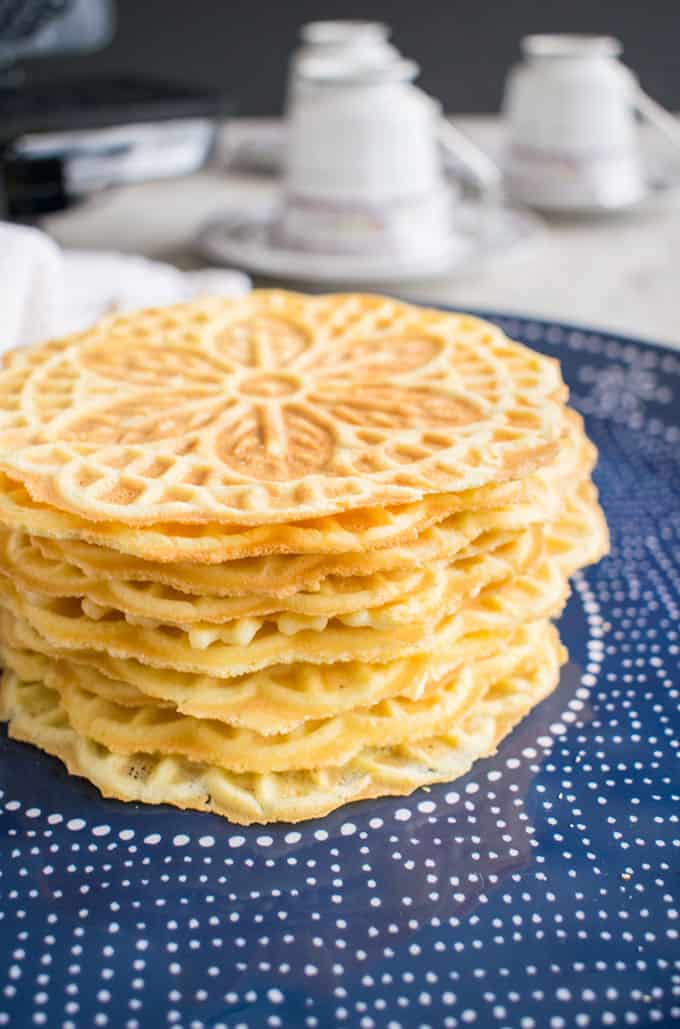 stack of almond pizzelle cookies on a plate