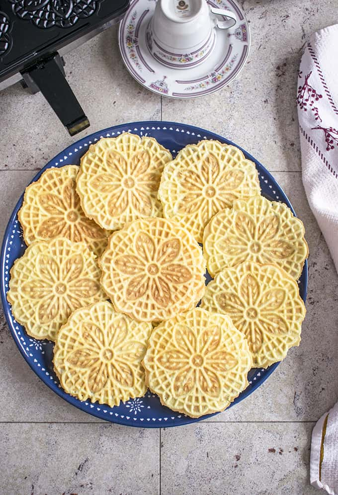 Almond Pizzelle Cookies - These Italian waffle cookies are light, crispy & delicious! Enjoy these for dessert, breakfast or snack. #pizzelle #cookies #pizzellerecipe