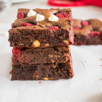 stack of triple chocolate raspberry brownies