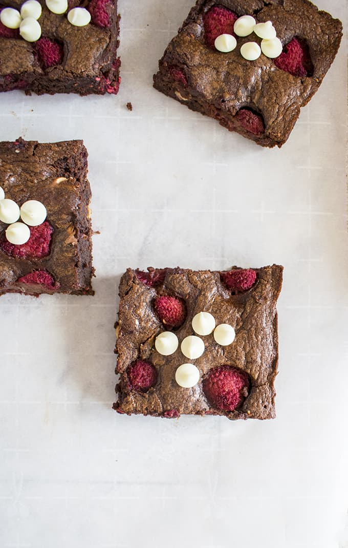 overhead photo of four triple chocolate raspberry brownies