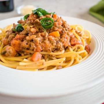 Spaghetti Bolognese - Authentic Bolognese sace made with half beef and half sausage. It tastes amazing!