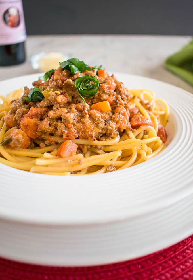 Spaghetti Bolognese - Authentic Bolognese sauce made with half beef and half sausage. It tastes amazing! #bolognese #spaghettibolognese