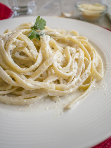 close-up photo of fettuccini with homemade alfredo sauce on a plate