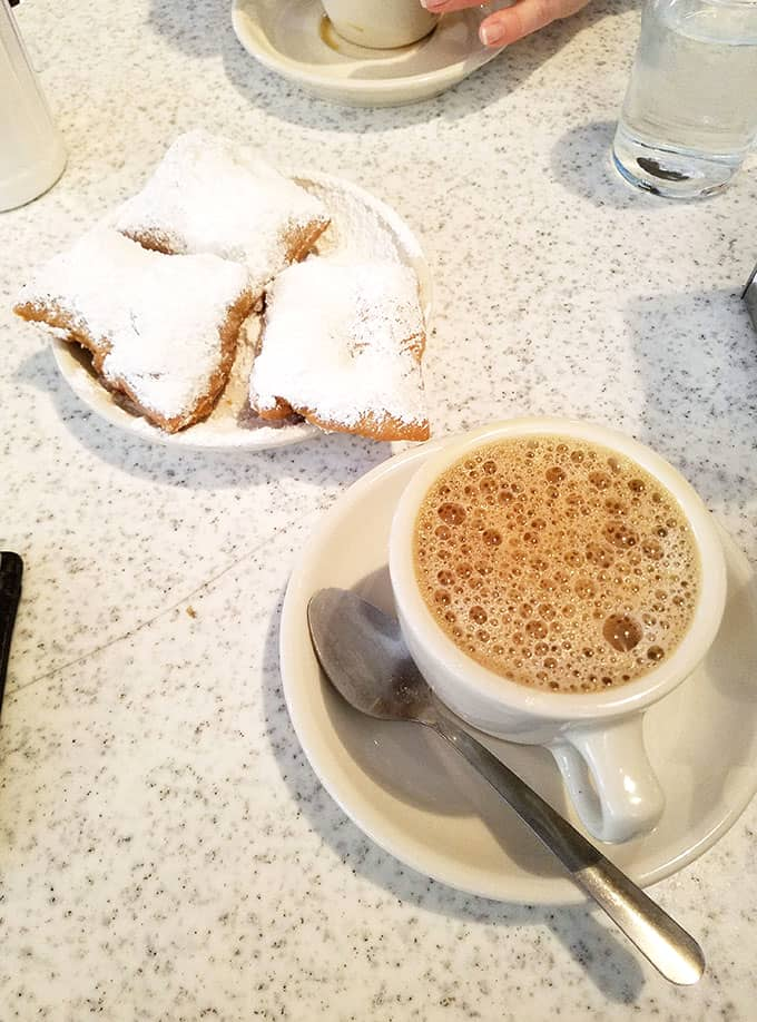 Beignets and Cafe au Lait from Cafe du Monde in New Orleans - New Orleans Restaurants and Highlights from Our Trip #neworleans #neworleanstravel #nola