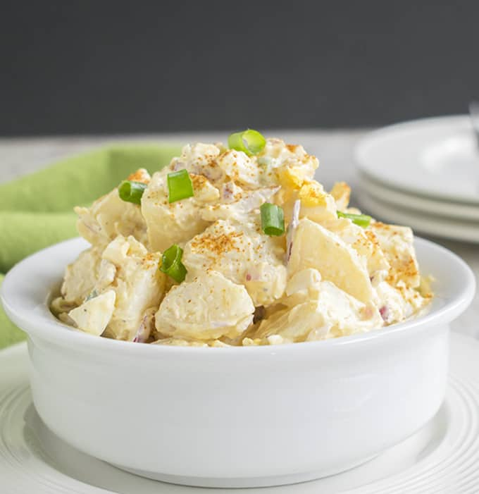 close-up photo of deviled egg potato salad in a bowl