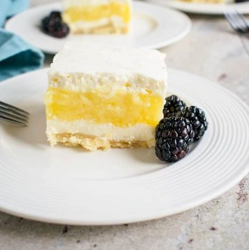 Lemon Lush from Scratch - A buttery crust topped with sweetened cream cheese, homemade lemon pie filling and whipped cream! #lemonlush #lemonlasagna #lemondesserts