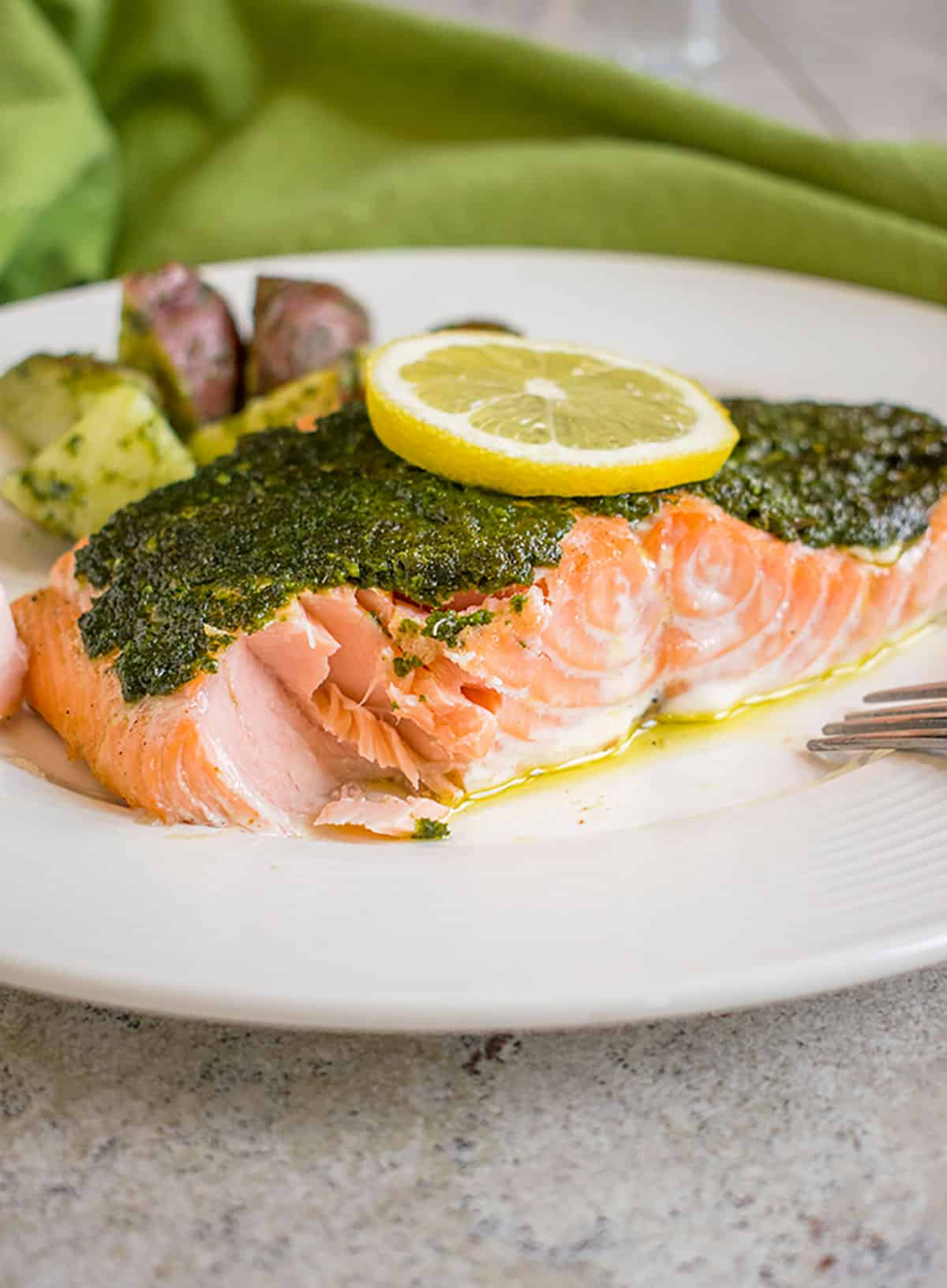 Photo of plate with pesto salmon and potatoes