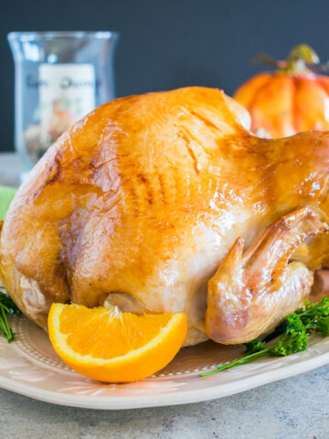 photo of Mom's Thanksgiving Turkey on a platter with orange wedge