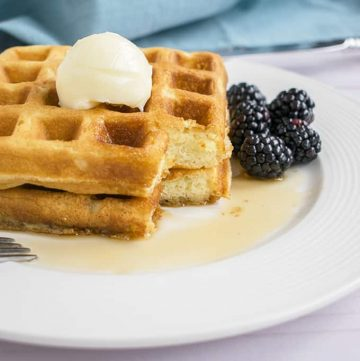 Photo of plate of Homemade Waffles with butter, syrup and blackberries