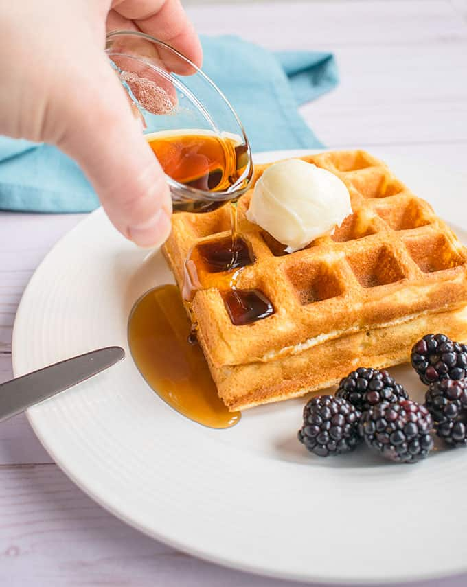 Photo of pouring maple syrup on Homemade Waffles