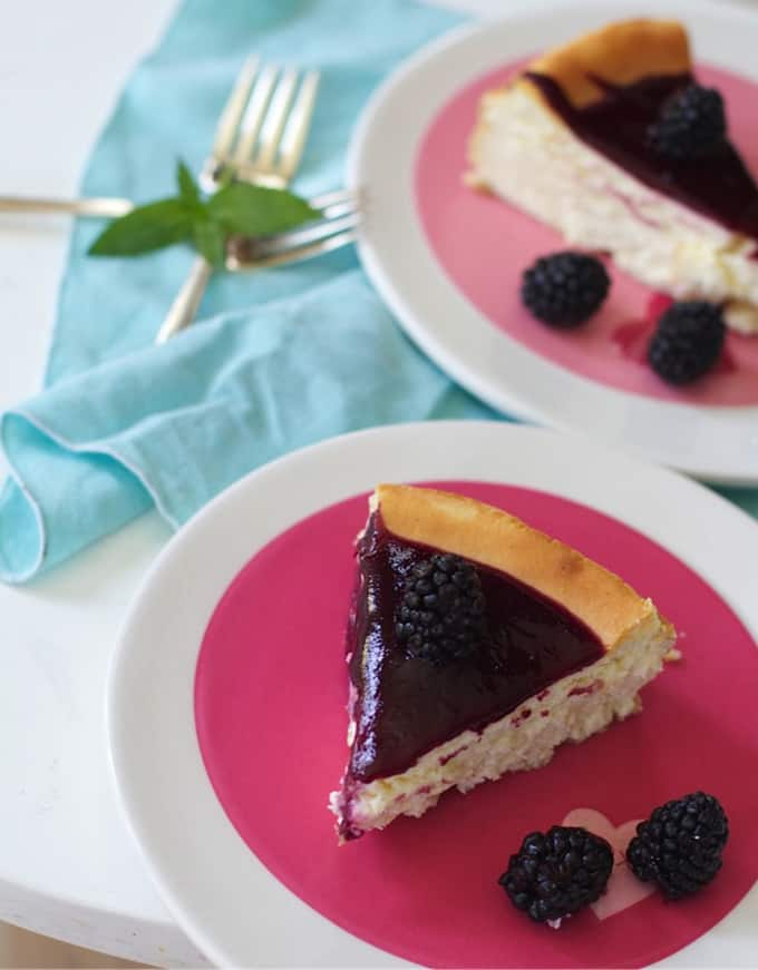 plate of cheesecake with blackberry topping