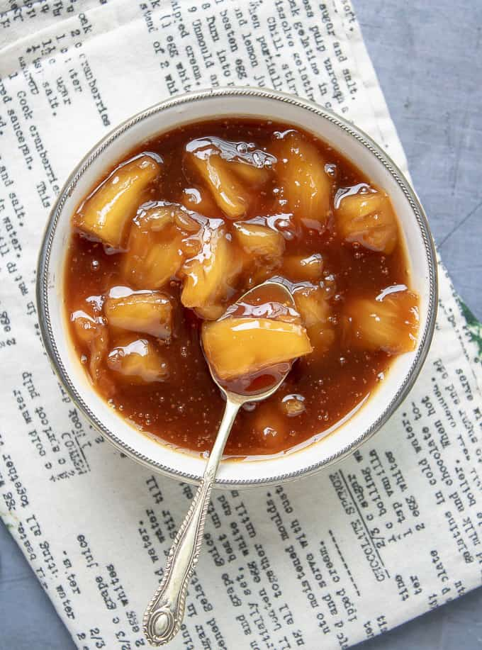 bowl of pineapple compote with spoonful