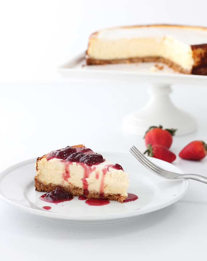 plate of cheesecake with Strawberry Pinto Reduction Sauce