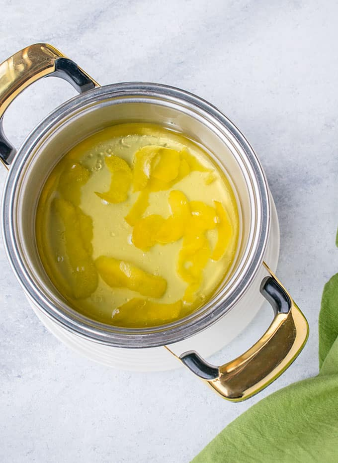 pot of olive oil with lemon peels