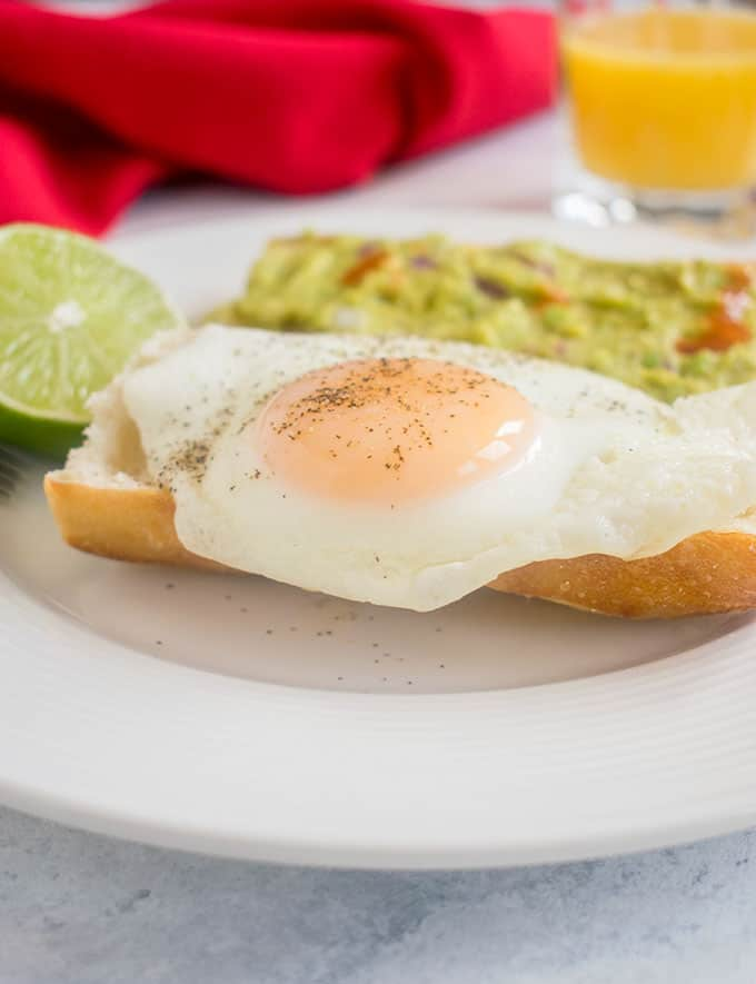 Basted egg on a toasted baguette with guacamole on toast