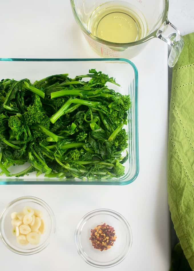 blanched rapini (broccoli rabe) with olive oil,  garlic slices, red pepper flakes