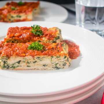 Two slices of Italian Meatloaf with chicken on stacked plates