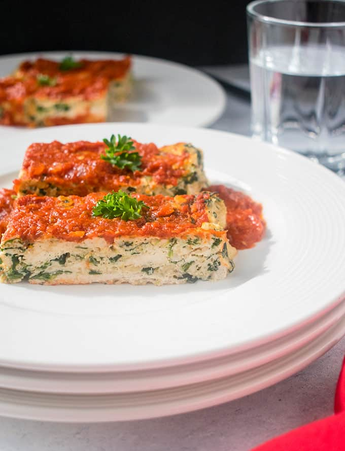 stacked plates with two slices of Italian meatloaf with chicken