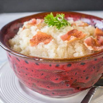 bowl of mashed turnips with bacon and parsley