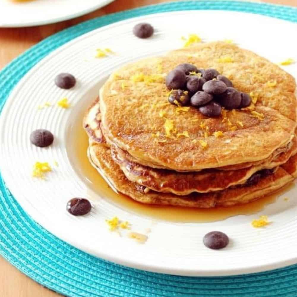 stack of pancakes with chocolate chips and orange zest