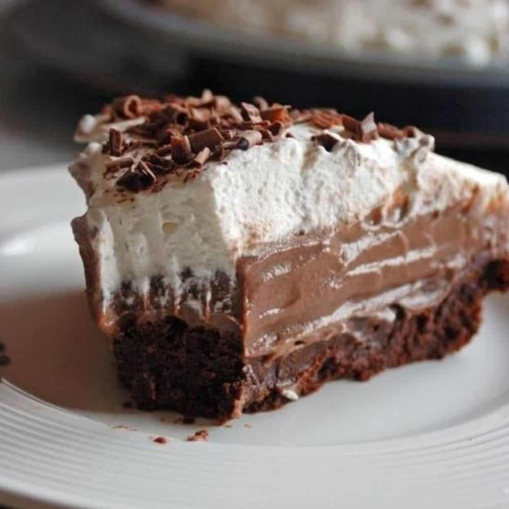 slice of chocolate pie with whipped cream, chocolate curls