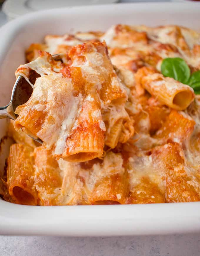 spoonful of baked rigatoni with cheese and marinara