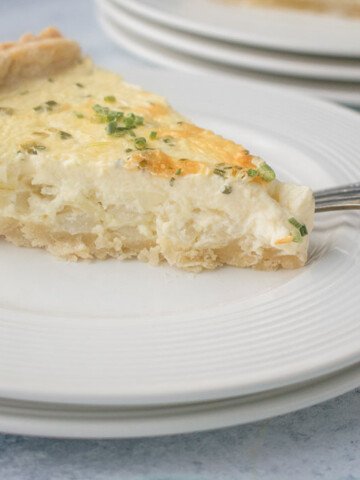 slice of onion pie on plate with fork