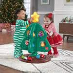 babies playing with toy Christmas tree