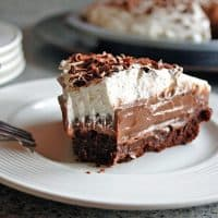 slice of chocolate pudding pie with brownie crust and whipped cream