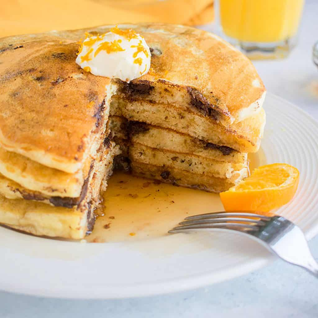 stack of chocolate chip pancakes cut open