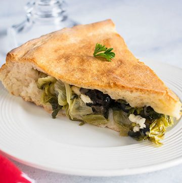 slice of stuffed pizza with escarole